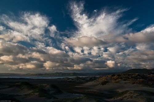 1 of 3 Spectacular reflections of sky on wet sand